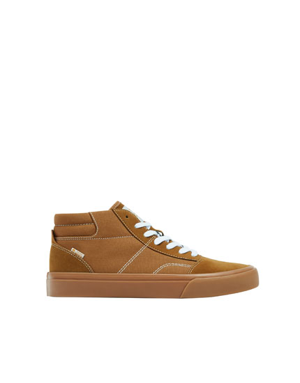 Brown high-top teen trainers
