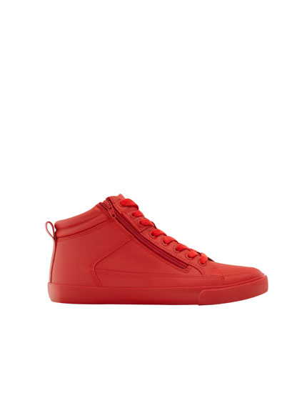 Red high-top sneakers with zip