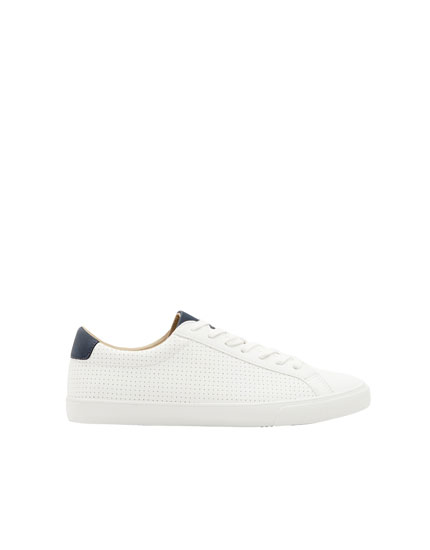 Perforated trainers with blue heel cap