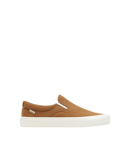 Brown plimsolls with elastic tabs