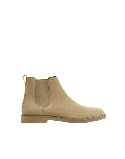 Beige leather stretch ankle boots