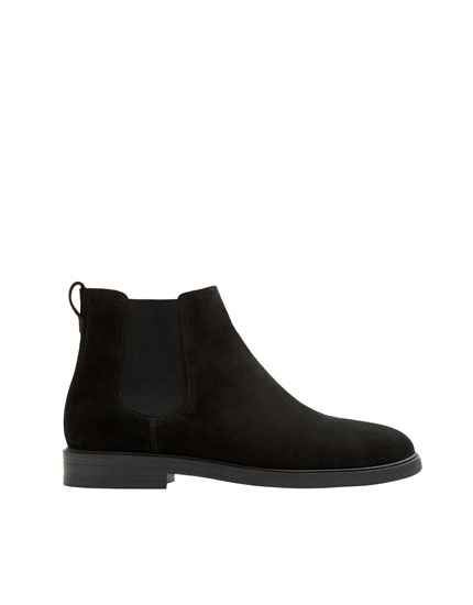 Black leather stretch ankle boots