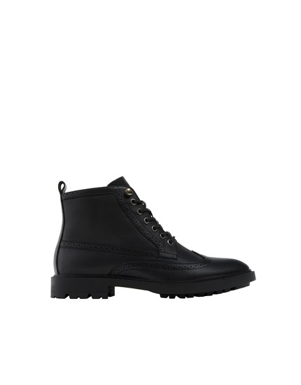 Perforated black worker boots