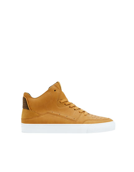 Mustard yellow die-cut high-top trainers