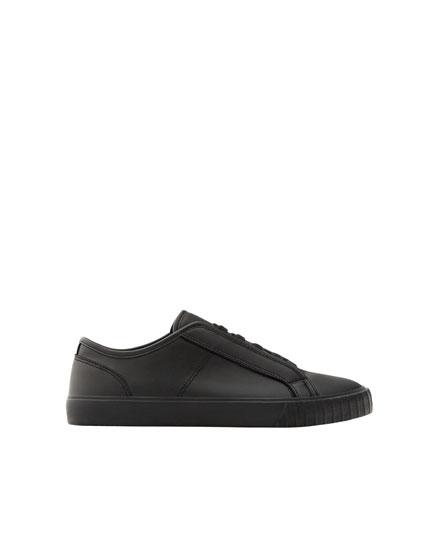All-black sneakers