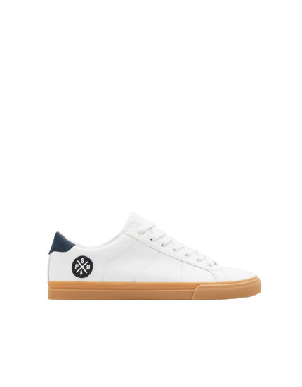 White trainers with patch
