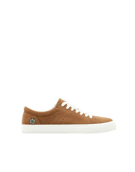Brown sneakers with patch on heel