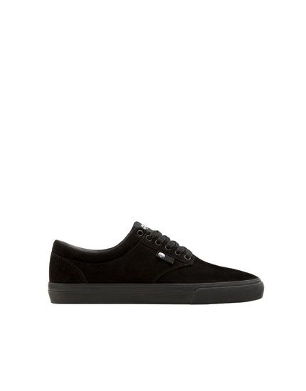Basic black teen trainers