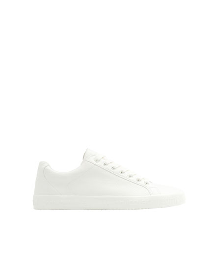 White trainers with lettering