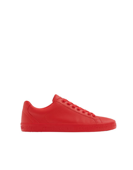 Red trainers with lettering
