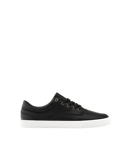 Black trainers with lining