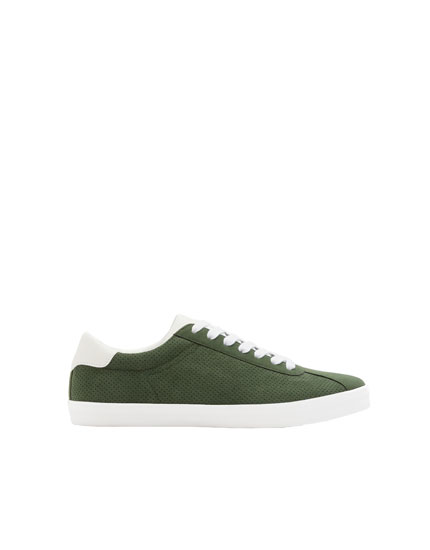Perforated green trainers