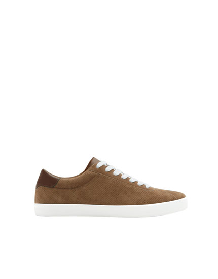 Perforated brown trainers