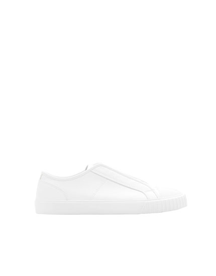 White monochrome sneakers with toe cap