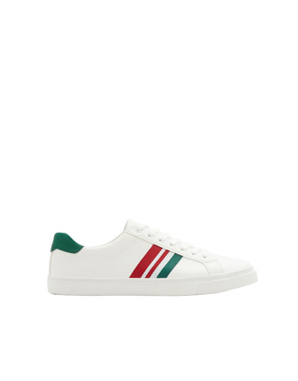 Trainers with green stripe detail