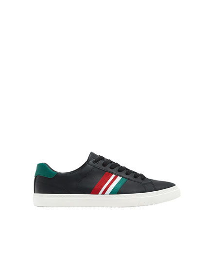 Sneakers with black stripe detail