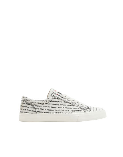 Trainers with lettering and embroidery