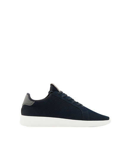 Navy blue fabric sneakers