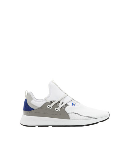 White sock-style strap trainers