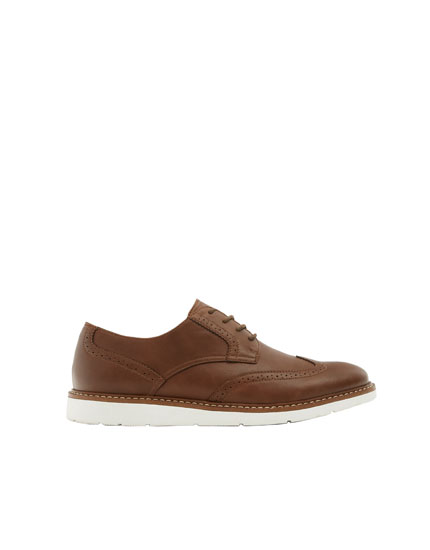 Brown shoes with broguing