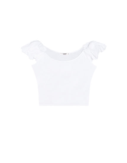 Loose-fitting top with thin straps