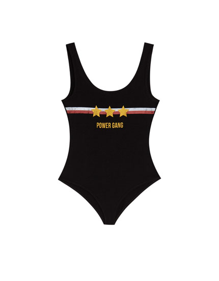 Bodysuit with straps and slogan