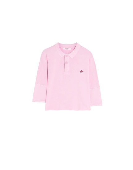 Embroidered pink polo shirt