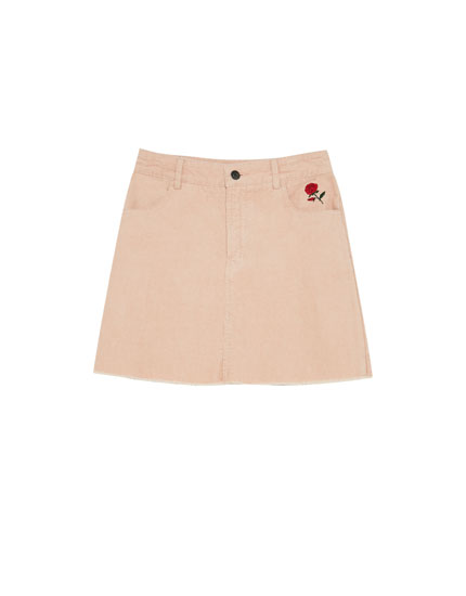 Corduroy skirt with embroidered rose