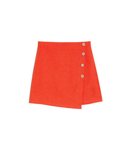 Mini skirt with side buttons