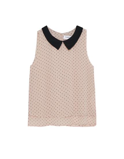 Sleeveless top with a shirt collar