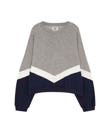 Blue sweatshirt with V-shaped panels