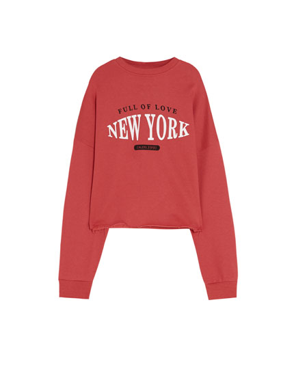 Red cropped sweatshirt with slogan