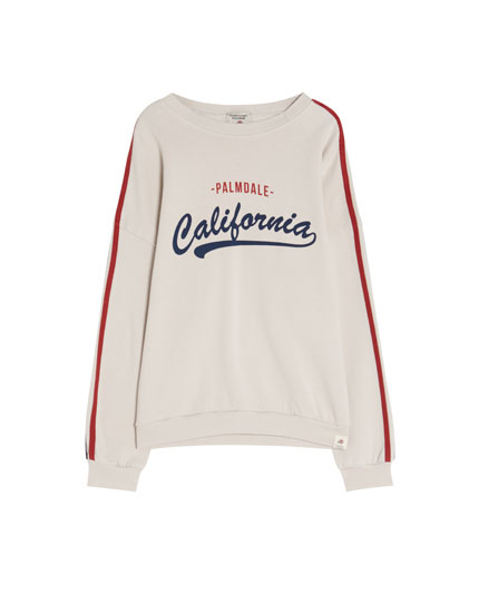 Sweatshirt with slogan and side stripes
