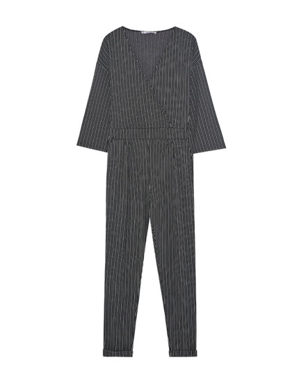 Striped tailored jumpsuit with crossover neckline