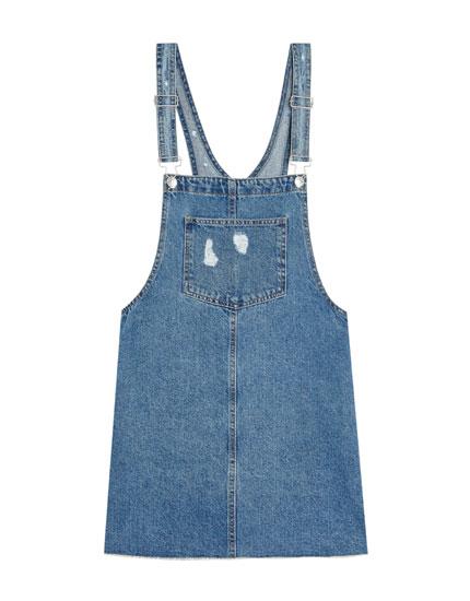 Denim pinafore dress with unfinished hem