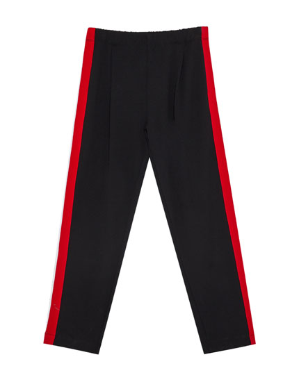Trousers with darts and side stripes