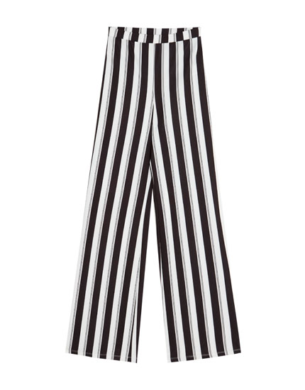 Belled trousers with vertical stripes