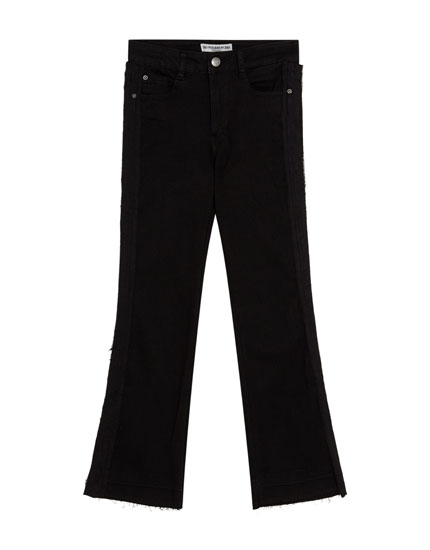 Cropped flared jeans with frayed hem