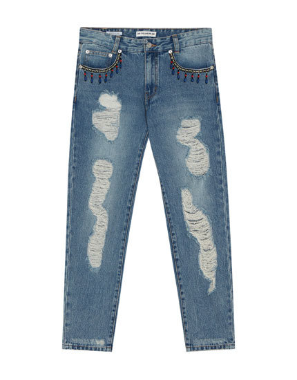 Ripped mom jeans with embellishment