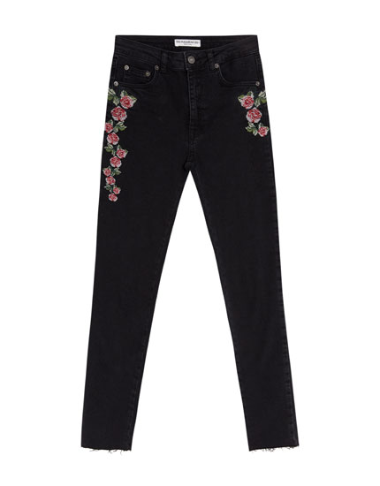 Skinny jeans with cross-stitch embroidery