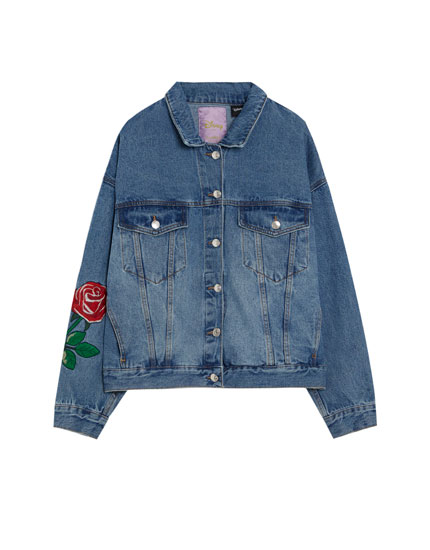 Oversized denim jacket with embroidered 'Beauty and the Beast' details