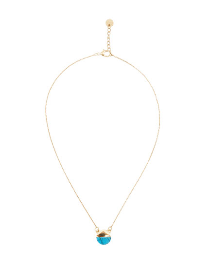 Golden necklace with a stone pendant