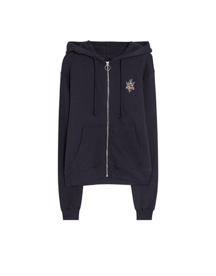 Sweatshirt with zip and patch
