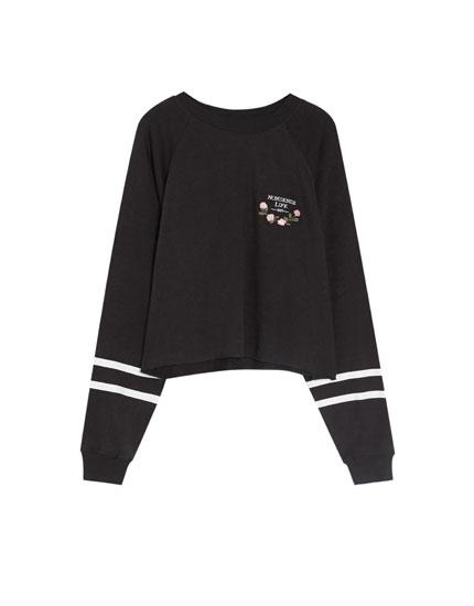 Basic sweatshirt med striber på ærmerne