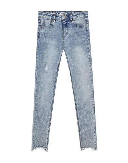 Jeans with ripped hems