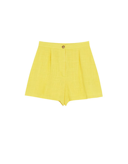 Yellow Bermuda shorts with darts