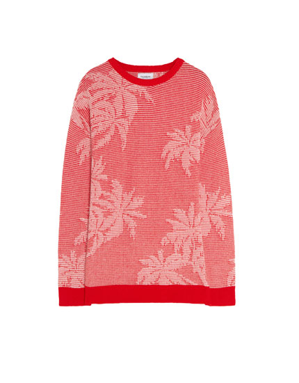 Red sweater with palm tree print