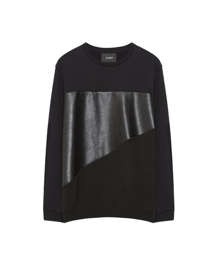 Sweatshirt with faux leather panel