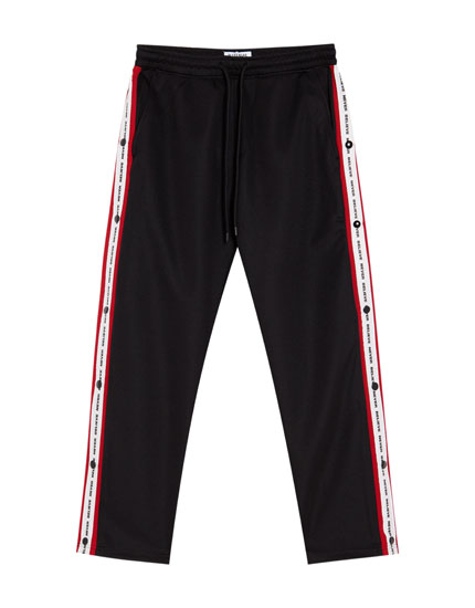 Jogging trousers with buttoned side taping
