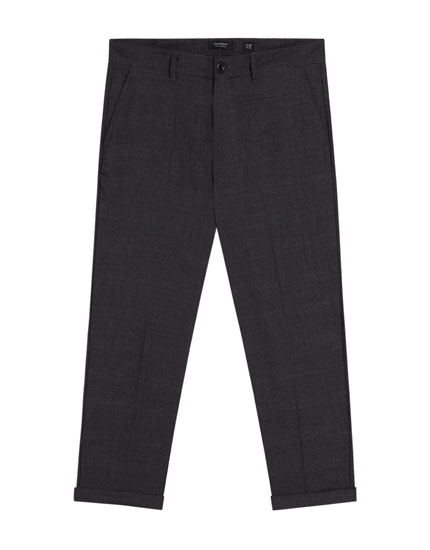 Tailored trousers with turn-up hems